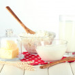 Dairy produce on a light wooden table — Stock Photo