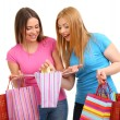 Two girl friends with shopping isolated on white - Foto de Stock