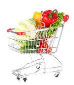 świeże warzywa w wózku na białym tle — Zdjęcie stockowe