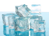 Ice cubes on white background — Stock Photo