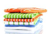 Orange potholder and stack of kitchen towels isolated on white — Stock Photo