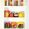 Homemade preserves on beautiful white shelves — Stock Photo #23930405