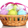 colorful easter eggs in basket isolated on white — Stock Photo
