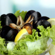Royalty-Free Stock Photo: Snack of mussels and lemon on vase on room background close-up