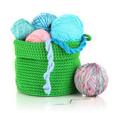 Colorful yarn for knitting in green basket isolated on white — Stock Photo