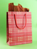 Shopping bag on green background — Stock Photo