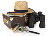 Black modern binoculars with suitcase and straw hat isolated on white — Stock Photo