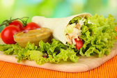 Kebab - grilled meat and vegetables, on bamboo mat, on bright background — Stock Photo