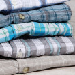 Shirts neatly folded close-up — ストック写真