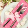 Table setting in white and pink tones on color  wooden background - Stock Photo