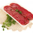 Tasty salami on plate on  napkin isolated on white - Stock Photo