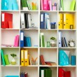 White office shelves with different stationery, close up — Stock Photo #23940663
