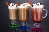 Layered coffee in glass on table on grey background — Stock Photo