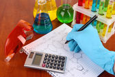 Hand scientist writing formulas — Stock Photo