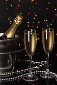 Celebratory champagne with stemware on Christmas lights background — Stock Photo