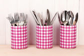 Utensils in metal containers isolated on light background — Stock Photo