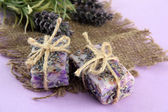 Natural handmade soap, on purple background — Stock Photo
