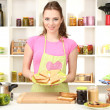 Young woman cooking in kitchen — Stock Photo