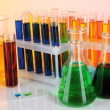 Colorful test tubes on light background - Stock Photo