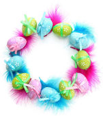 Wreath of bright easter eggs and decorative feathers, isolated on white — Stockfoto