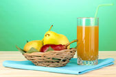 Pear juice with pears on wooden table on blue background — Stock Photo