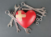 Heart and tools. Concept: Renovation of heart. On color background — Photo