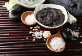 Composition with cosmetic clay for spa treatments, on bamboo background — Stock Photo