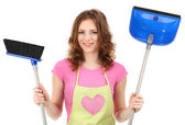 Young housewife with broom and dustpan, isolated on white — Stock Photo
