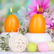 Easter candles with flowers on bright background — ストック写真