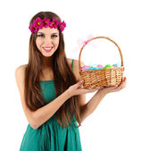Happy female holding basket with Easter eggs, isolated on white — Stock Photo