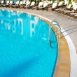 Hotel swimming pool with sunny reflection — Stock Photo