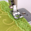 Closeup of sewing machine working part with green cloth — Stock Photo #24022847