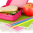 Lunch box with sandwich,apple and stationery isolated on white - Stock Photo