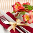Festive dining table setting with flowers on checkered background — Stock Photo #24023623