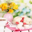 Beautiful set with tea on wooden picnic table on natural background — Stock Photo