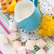 Beautiful composition of milk and cookies on wooden picnic table close-up — Stock Photo