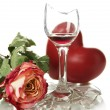 Broken wineglass with dry rose and decorative heart isolated on white - Stock Photo