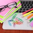 Laptop with stationery on table - Stock Photo