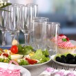 Table setting on room background — Stock Photo #24024169