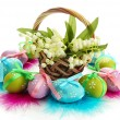 Beautiful easter eggs and lilies of the valley in basket , isolated on white - 图库照片