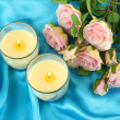 Candles on blue fabric close-up - Foto Stock