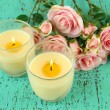 Candles on wooden table close-up - Stockfoto