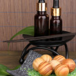 Aromatherapy setting on brown bamboo background — Stock Photo #24024983
