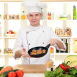 Chef cooking in kitchen — Stock Photo