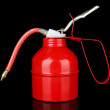 Stock Photo: Red oil can, isolated on black