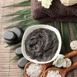 Composition with cosmetic clay for spa treatments, on bamboo background - Lizenzfreies Foto