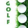 Golf balls on grass — Stock Photo