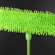 Green mop for floor on gray background - Stock Photo