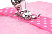 Closeup of sewing machine working part with pink cloth — Stock Photo