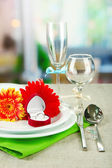 Table serving on bright background — Stockfoto